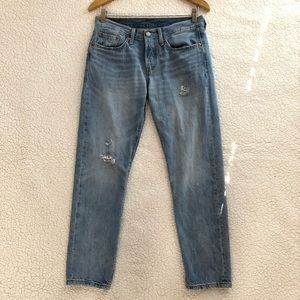 Levi's 501 tapered mid rise jeans in light wash